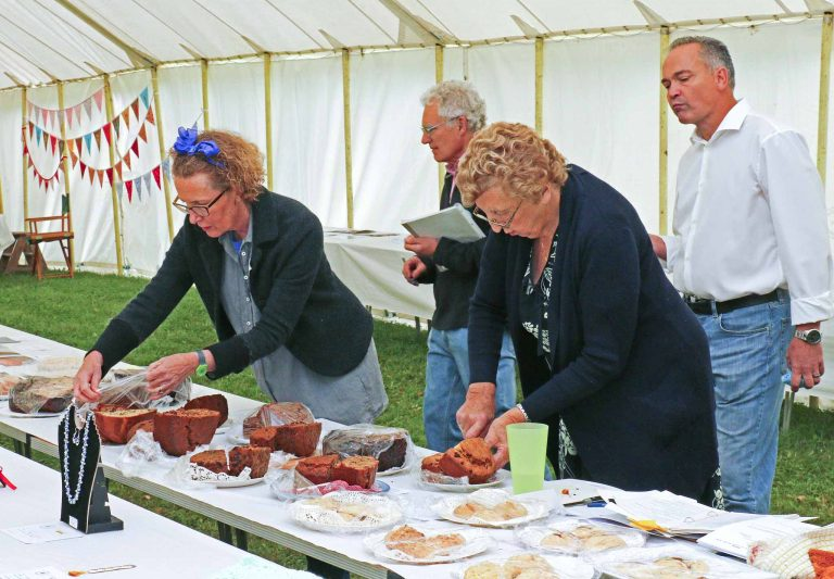 Judging is a serious business. Above, Katrina McCrossan and Pat Wickham assess cookery entries. | Peter Oldridge