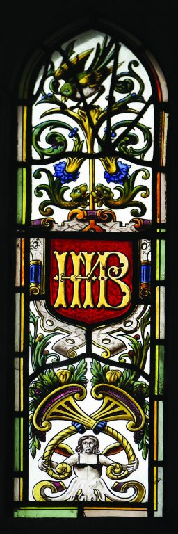 A second window representing the Higford Burrs. Mary Higford Burr's initials MHB are evident in the brickwork and othe details on the outside of the building.